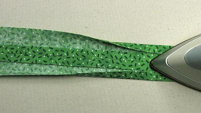 Press green tie